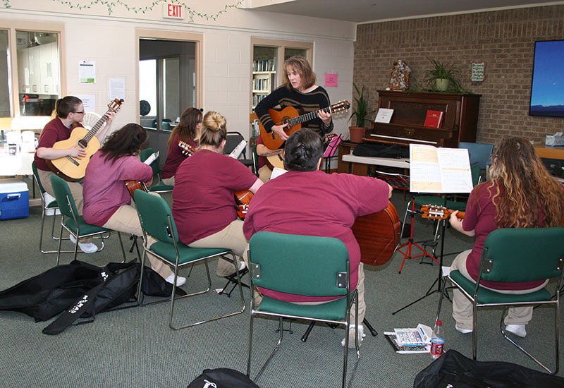 Guitar classes at the Montana Women's Prison